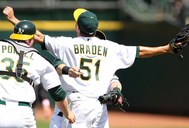 OAKLAND, CA - MAY 09:  Dallas Braden #51 of the Oakland Athletics celebrates after pitching a perfect game against the Tampa Bay Rays during an MLB game at the Oakland-Alameda County Coliseum on May 9, 2010 in Oakland, California.  (Photo by Jed Jacobsohn