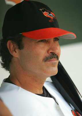 BALTIMORE, MD - AUGUST 29:  Rafael Palmeiro #25 of the Baltimore Orioles looks on from the dugout during the game against the Oakland Athletics on August 29, 2005 at Camden Yards in Baltimore, Maryland.  The A's won 10-5. (Photo By Jamie Squire/Getty Imag