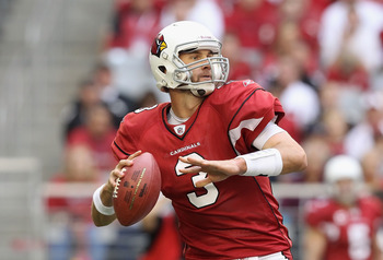 GLENDALE, AZ - DECEMBER 05:  Quarterback Derek Anderson #3 of the Arizona Cardinals scrambles to pass the football during the NFL game against the St. Louis Rams at the University of Phoenix Stadium on December 5, 2010 in Glendale, Arizona. The Rams defea