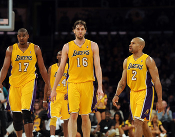 LOS ANGELES, CA - FEBRUARY 03: Pau Gasol #16, Derek Fisher #2 and Andrew Bynum #17 of the Los Angeles Lakers leave the court for a timeout trailing the San Antonio Spurs at Staples Center on February 3, 2011 in Los Angeles, California.  NOTE TO USER: User