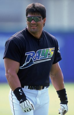 8 Mar 2000: Jose Canseco #33 of the  Tampa Bay Devil Rays smiles as he walks on the field during the Spring Training Game against the Philadelphia Phillies at Florida Power Park in St. Petersburgh, Florida. Mandatory Credit: Scott Halleran  /Allsport
