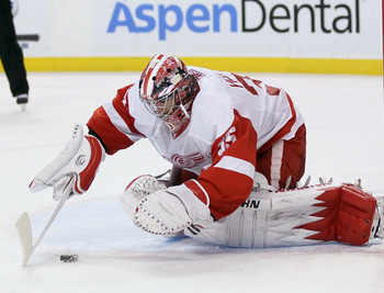 BOSTON, MA - FEBRUARY 11:  Jimmy Howard #35 of the Detroit Red Wings stops a shot in the third perido against the Boston Bruins on February 11, 2011 at the TD Garden in Boston, Massachusetts. The Red Wings defeated the Bruins 6-1.  (Photo by Elsa/Getty Im