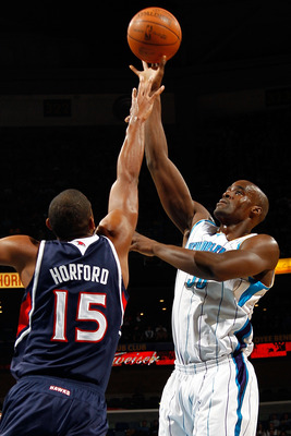 NEW ORLEANS, LA - DECEMBER 26:  Emeka Okafor #50 of the New Orleans Hornets shoots the ball over AL Horford #15 of the Atlanta Hawks at the New Orleans Arena on December 26, 2010 in New Orleans, Louisiana.  NOTE TO USER: User expressly acknowledges and ag