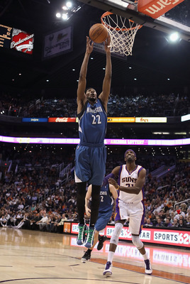 PHOENIX - DECEMBER 15:  Corey Brewer #22 of the Minnesota Timberwolves slam dunks the ball against the Phoenix Suns during the NBA game at US Airways Center on December 15, 2010 in Phoenix, Arizona. The Suns defeated the Timberwolves 128-122. NOTE TO USER