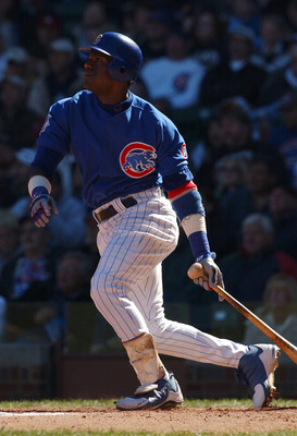 CHICAGO - OCTOBER 2:  Sammy Sosa #21 of the Chicago Cubs hits his 35th home run of the year and the 574th of his career putting him in sole possession of 7th place on the MLB all-time home run list during a game against the Atlanta Braves on October 2, 20