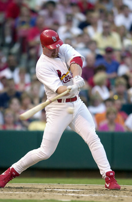 01 Aug 2000:  Mark McGwire #25 of the St. Louis Cardinals hit a two-run homer during the game against the Atlanta Braves at Busch Stadium in St. Louis, Missouri.  The Cardinals beat the Atlanta Braves 0-4.  DIGITAL IMAGE. Mandatory Credit: Elsa/ALLSPORT