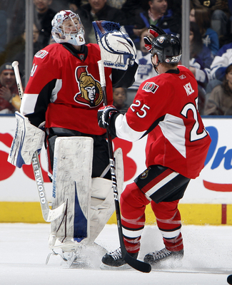 TORONTO, CANADA - FEBRUARY 19: Craig Anderson #41 and Chris Neil #25 of the Ottawa Senators celebrates shootout win at the Air Canada Centre against the Toronto Maple Leafs February 19, 2011 in Toronto, Ontario, Canada. (Photo by Abelimages/Getty Images)