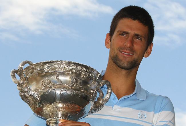 MELBOURNE, AUSTRALIA - JANUARY 31:  Novak Djokovic of Serbia poses with the Norman Brookes Challenge Cup at the Melbourne Cricket Ground on January 31, 2011 in Melbourne, Australia.  (Photo by Mark Dadswell/Getty Images)