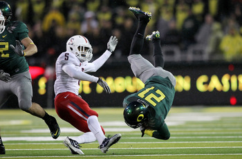 EUGENE, OR - NOVEMBER 26:  LaMichael James #21 of the Oregon Ducks is tackled by Shaquille Richardson #5 of the Arizona Wildcats on November 26, 2010 at the Autzen Stadium in Eugene, Oregon.  (Photo by Jonathan Ferrey/Getty Images)