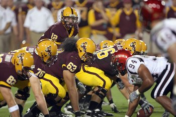 TEMPE, AZ - SEPTEMBER 15: Quarterback Rudy Carpenter #12 of the Arizona State Sun Devils calls the play during the game against the San Diego State Aztecs on September 15, 2007 at Sun Devil Stadium in Tempe, Arizona.  (Photo by Stephen Dunn/Getty Images)