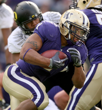 SEATTLE - OCTOBER 24:  Running back Chris Polk #1 of the Washington Huskies rushes against the Oregon Ducks on October 24, 2009 at Husky Stadium in Seattle, Washington. The Ducks defeated the Huskies 43-19. (Photo by Otto Greule Jr/Getty Images)