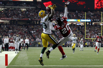ATLANTA, GA - JANUARY 15:  James Jones #89 of the Green Bay Packers scores a 20-yard touchdown reception in the second quarter against Brent Grimes #20 of the Atlanta Falcons during their 2011 NFC divisional playoff game at Georgia Dome on January 15, 201