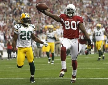 GLENDALE, AZ - JANUARY 10:  Wide receiver Early Doucet #80 of the Arizona Cardinals scores a touchdown against the Green Bay Packers during the first quarter of the 2010 NFC wild-card playoff game at University of Phoenix Stadium on January 10, 2010 in Gl