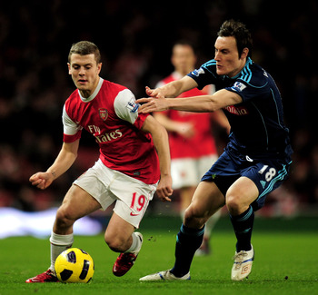 LONDON, ENGLAND - FEBRUARY 23:  Jack Wilshere (L) of Arsenal is challenged by Dean Whitehead of Stoke during the Barclays Premier League match between Arsenal and Stoke City at the Emirates Stadium on February 23, 2011 in London, England.  (Photo by Shaun