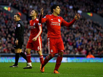 LIVERPOOL, ENGLAND - FEBRUARY 12:  Luis Suarez of Liverpool reacts to a missed chance during the Barclays Premier League match between Liverpool and Wigan Athletic at Anfield on February 12, 2011 in Liverpool, England.  (Photo by Clive Brunskill/Getty Ima