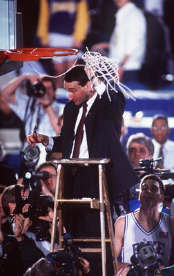 APR 1991:  MIKE KRZYZEWSKI, HEAD COACH OF DUKE BASKETBALL, CUTS DOWN THE NET AFTER WINNING THE NCAA NATIONAL CHAMPIONSHIP.   DUKE BEAT KANSAS 72-65 AT THE HOOSIER DOME, INDIANAPOLIS, INDIANA. Mandatory Credit: ALLSPORT USA/ALLSPORT