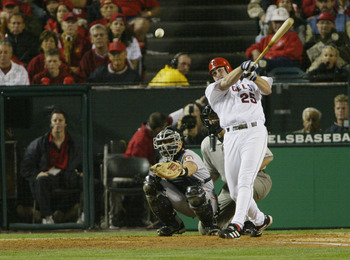 ANAHEIM, CA - OCTOBER 26:  Troy Glaus #25 of the Anaheim Angels hits the ball against the San Francisco Giants during game six of the World Series on October 26, 2002 at Edison Field in Anaheim, California. The Angels defeated the Giants 6-5. (Photo by Je