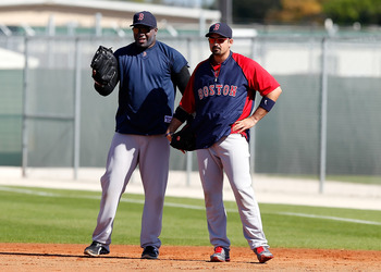 FORT MYERS, FL - FEBRUARY 19:  Designated hitter David Ortiz #34 and first baseman Adrian Gonzalez #28 of the Boston Red Sox wait for ground balls during a Spring Training Workout Session at the Red Sox Player Development Complex on February 19, 2011 in F