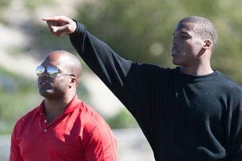 SAN DIEGO, CA - FEBRUARY 10:  2010 Heisman Trophy winning quarterback Cam Newton of the Auburn Tigers goes through his workout routine with trainer George Whitfield for the media at Cathedral High School's sports stadium on February 10, 2011 in San Diego,