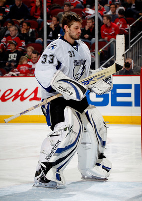 NEWARK, NJ - JANUARY 09:  Goalie Dan Ellis #33 of the Tampa Bay Lightning skates without his mask during a break in action in an NHL hockey game against the New Jersey Devils at the Prudential Center on January 9, 2011 in Newark, New Jersey.  (Photo by Pa
