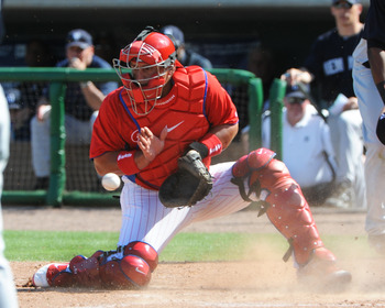 CLEARWATER, FL - FEBRUARY 27:  Catcher Carols Ruiz #51 of the Philadelphia Phillies blocks a throw to the plate against the New York Yankees February 27, 2011 at Bright House Field in Clearwater, Florida.  (Photo by Al Messerschmidt/Getty Images)
