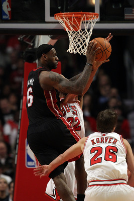 CHICAGO, IL - FEBRUARY 24: LeBron James #6 of the Miami Heat leaps to pass over Taj Gibson #22 and Kyle Korver #26 of the Chicago Bulls at the United Center on February 24, 2011 in Chicago, Illinois. The Bulls defeated the Heat 93-89. NOTE TO USER: User e