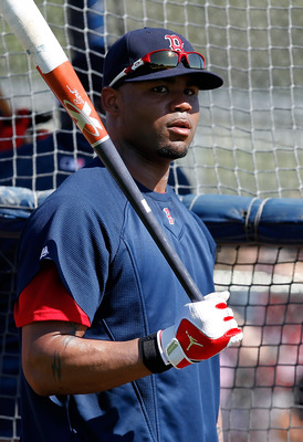FORT MYERS, FL - FEBRUARY 19:  Outfielder Carl Crawford #13 of the Boston Red Sox takes batting practice during a Spring Training Workout Session at the Red Sox Player Development Complex on February 19, 2011 in Fort Myers, Florida.  (Photo by J. Meric/Ge