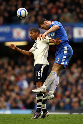 LONDON, ENGLAND - FEBRUARY 19:  Branislav Ivanovic of Chelsea rises above Jermaine Beckford of Everton to win a header during the FA Cup sponsored by E.ON 4th round replay match between Chelsea and Everton at Stamford Bridge on February 19, 2011 in London