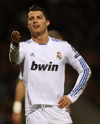 LYON, FRANCE - FEBRUARY 22:  Cristiano Ronlado of Real Madrid looks dejected during the Champions League match between Lyon and Real Madrid at Stade Gerland on February 22, 2011 in Lyon, France.  (Photo by Scott Heavey/Getty Images)