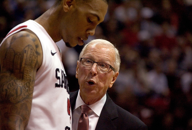 SAN DIEGO, CA - FEBRUARY 26:  Coach Steve Fisher (R) speaks with Malcolm Thomas #4 of the San Diego State Aztecs during a time out against the Brigham Young Cougars during the second half at Cox Arena on February 26, 2011 in San Diego, California. (Photo
