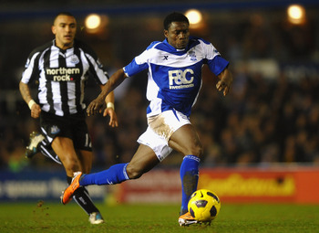 BIRMINGHAM, ENGLAND - FEBRUARY 15: Obafemi Martins of Birmingham City breaks from Danny Simpson of Newcastle United during the Barclays Premier League match between Birmingham City and Newcastle United at St Andrews  on February 15, 2011 in Birmingham, En