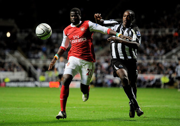 NEWCASTLE UPON TYNE, ENGLAND - OCTOBER 27:  Nile Ranger of Newcastle United competes with Emmanuel Eboue of Arsenal during the Carling Cup Fourth Round match between Newcastle United and Arsenal at St James' Park on October 27, 2010 in Newcastle, England.