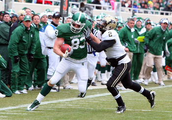 EAST LANSING, MI - NOVEMBER 08:  Charlie Gantt #83 of the Michigan State Spartans runs the ball against Torri Williams #2 of the Purdue Boilermakers at Spartan Stadium on November 8, 2008 in East Lansing, Michigan.  (Photo by Jim McIsaac/Getty Images)