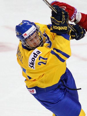 BUFFALO, NY - JANUARY 03: Rickard Rakell #27 of Sweden collides with Andrei Sergeyev #26 of  Russia during the 2011 IIHF World U20 Championship Semi Final game between Sweden and Russia on January 3, 2011 in Buffalo, New York. Russia won 4-3 and faces Can