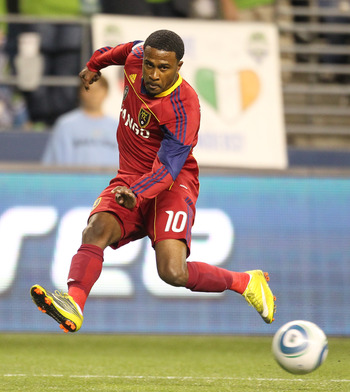 SEATTLE - SEPTEMBER 09:  Robbie Findley #10 of Real Salt Lake passes against the Seattle Sounders FC on September 9, 2010 at Qwest Field in Seattle, Washington. (Photo by Otto Greule Jr/Getty Images)