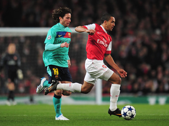 LONDON, ENGLAND - FEBRUARY 16: Theo Walcott of Arsenal goes past Maxwell of Barcelona during the UEFA Champions League round of 16 first leg match between Arsenal and Barcelona at the Emirates Stadium on February 16, 2011 in London, England.  (Photo by Sh