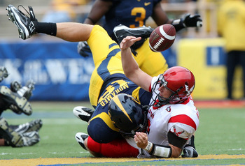 BERKELEY, CA - SEPTEMBER 12:  Mike Mohamed #18 of the California Golden Bears sacks Matt Nichols #16 of the Eastern Washington Eagles at Memorial Stadium on September 12, 2009 in Berkeley, California.  (Photo by Jed Jacobsohn/Getty Images)