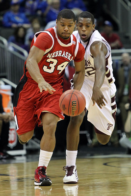 KANSAS CITY, MO - MARCH 11:  Lance Jeter #34 of the Nebraska Cornhuskers and Khris Middleton #22 of the Texas A&M Aggies go after the ball in the first half during the quarterfinals of the 2010 Phillips 66 Big 12 Men's Basketball Tournament at the Sprint