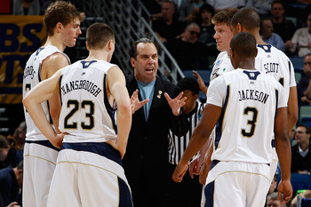 NEW ORLEANS - MARCH 18:  Head coach Mike Brey of the Notre Dame Fighting Irish talks with his team during a timeout against the Old Dominion Monarchs during the first round of the 2010 NCAA men's basketball tournament at the New Orleans Arena on March 18,