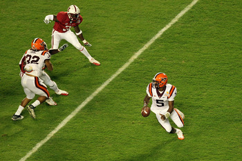 MIAMI, FL - JANUARY 03:  Tyrod Taylor #5 of the Virginia Tech Hokies rolls out of the pocket against the Stanford Cardinal during the 2011 Discover Orange Bowl at Sun Life Stadium on January 3, 2011 in Miami, Florida. Stanford won 40-12. (Photo by Mike Eh
