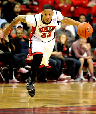 LAS VEGAS, NV - DECEMBER 30:  Tre'Von Willis #33 of the UNLV Rebels brings the ball up the court against the Central Michigan Chippewas during their game at the Thomas & Mack Center December 30, 2010 in Las Vegas, Nevada. UNLV won 73-47.  (Photo by Ethan