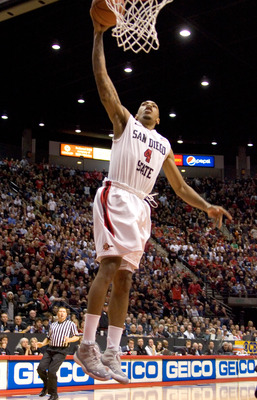 SAN DIEGO, CA - FEBRUARY 26:  Malcolm Thomas #4 of the San Diego State Aztecs dunks the ball against the Brigham Young Cougars during the second half at Cox Arena on February 26, 2011 in San Diego, California. (Photo by Kent Horner/Getty Images)