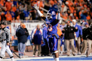 BOISE, ID - NOVEMBER 28: Jeron Johnson #23 of the Boise State Broncos celebrates a touchdown during their game against the Fresno State Bulldogs on November 28, 2008 at Bronco Stadium in Boise, Idaho.  (Photo by Otto Kitsinger III/Getty Images)