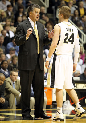 WEST LAFAYETTE, IN - JANUARY 09:  Matt Painter the Head Coach of the Purdue Boilermakers gives instructions to Ryne Smith #24 during the Big Ten Conference game against the Iowa Hawkeyes at Mackey Arena on January 9, 2011 in West Lafayette, Indiana.  Purd