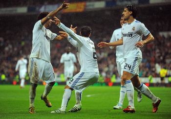 MADRID, SPAIN - FEBRUARY 19:  Ricardo Carvalho (C) of Real Madrid celebrates with Marcelo (L) and Sami Khedira after scoring Real's 2nd goal during the  La Liga match between Real Madrid and Levante at Estadio Santiago Bernabeu on February 19, 2011 in Mad