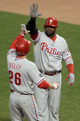 SAN FRANCISCO - OCTOBER 20:  (L-R) Chase Utley #26 and Ryan Howard #6 of the Philadelphia Phillies celebrate after Utley scored on a double by Placido Polanco #27 against the San Francisco Giants in the fifth inning of Game Four of the NLCS during the 201