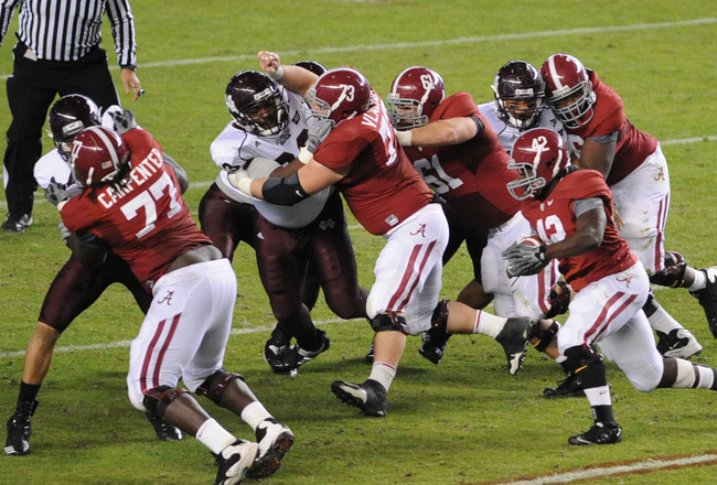 TUSCALOOSA, AL - NOVEMBER 13: Running back Eddie Lacy #42 of the Alabama Crimson Tide rushes upfield against the Mississippi State Bulldogs November 13, 2010 at Bryant-Denny Stadium in Tuscaloosa, Alabama.  (Photo by Al Messerschmidt/Getty Images)