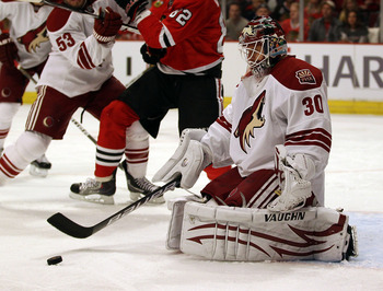 CHICAGO, IL - FEBRUARY 27: Ilya Bryzgalov #30 of the Phoenix Coyotes stops a shot against the Chicago Blackhawks at the United Center on February 27, 2011 in Chicago, Illinois. The Blackhawks defeated the Coyotes 4-3 in a shootout.  (Photo by Jonathan Dan