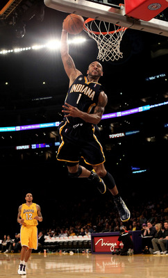 LOS ANGELES - MARCH 2:  Dahntay Jones #1 of the Indiana Pacers goes up for a breakaway dunk against the Los Angeles Lakers on March 2, 2010 at Staples Center in Los Angeles, California. The Lakers won 122-99.  NOTE TO USER: User expressly acknowledges and