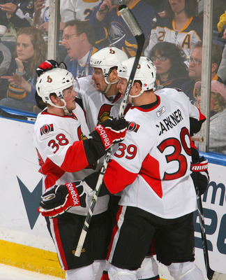 BUFFALO, NY - FEBRUARY 25: Erik Condra #38, Jason Spezza #19 and Matt Carkner #39 of the Ottawa Senators celebrate Spezza's goal in the second period against the Buffalo Sabres at HSBC Arena on February 25, 2011 in Buffalo, New York.  (Photo by Rick Stewa